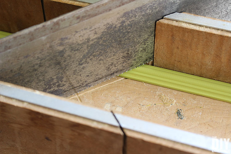 Use a miter box and hand saw to cut moulding to size.