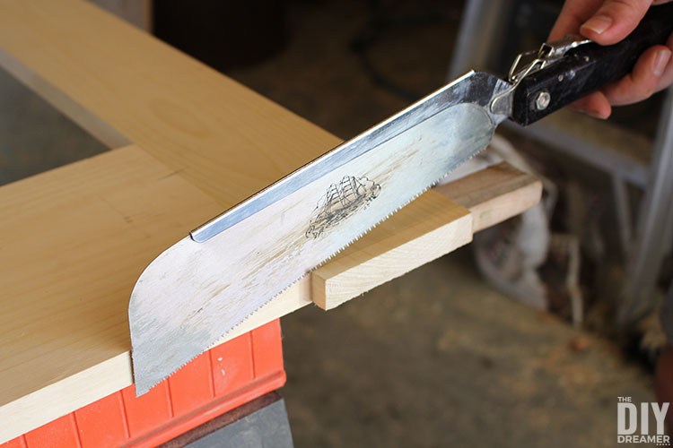 Use a hand saw to cut off extra wood.
