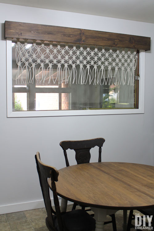 Wooden window cornice with macrame valance.