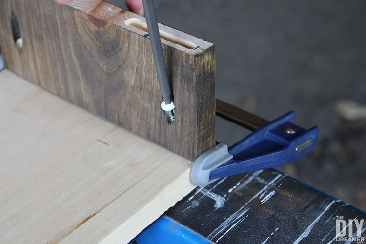 Attach pieces of wood together with screws inside pocket holes.