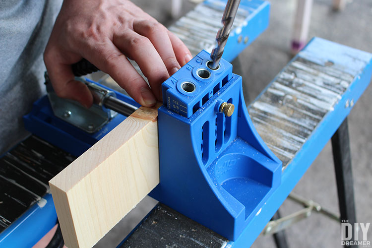 Use Kreg Jig to make pocket holes to attach pieces of wood together.