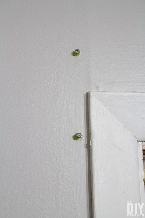 Drywall plugs with screws.
