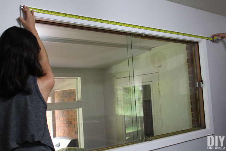 Measure window and window frame to determine the size of the window cornice.