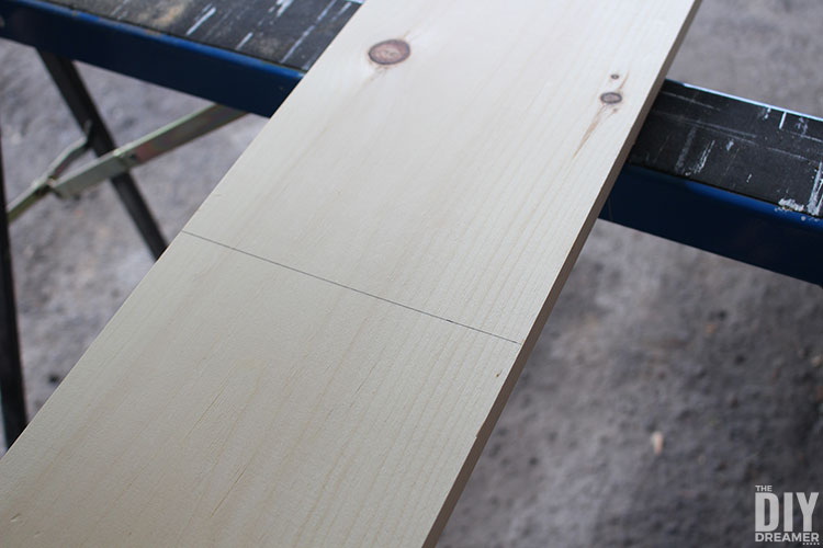 Pine board with cut line.