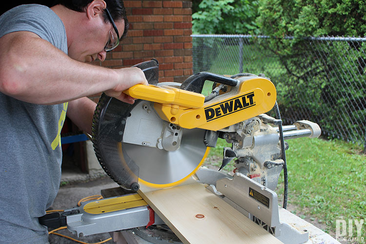 Use a miter saw to cut board.