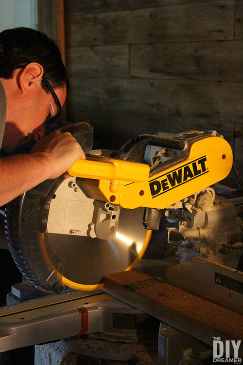 Cut lumber with a miter saw.