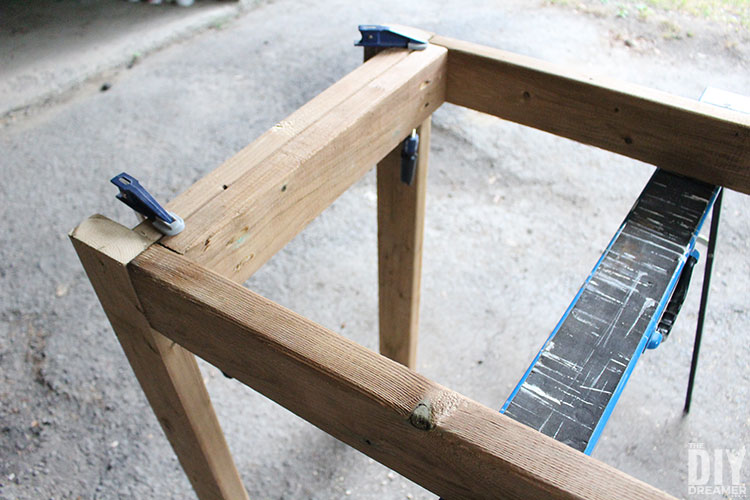 Attaching legs to the table frame.