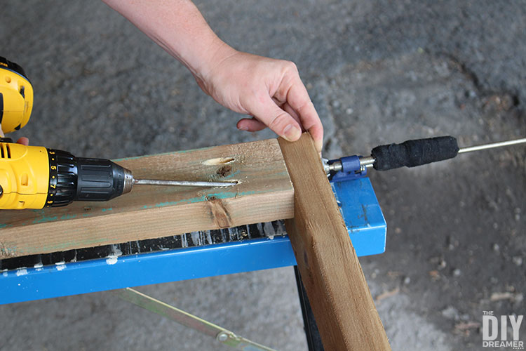 Attach board to side to create legs for the table.