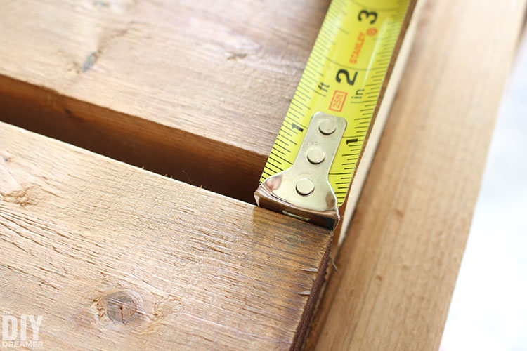 Measuring the spacing between the boards.