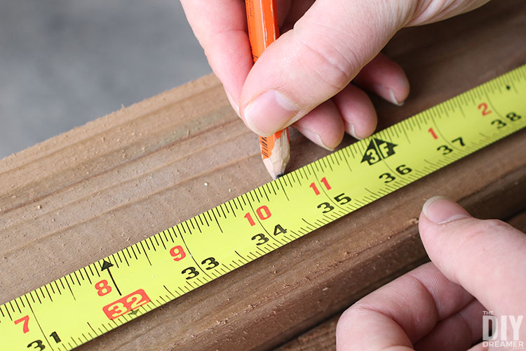 Measure and mark lumber where to cut