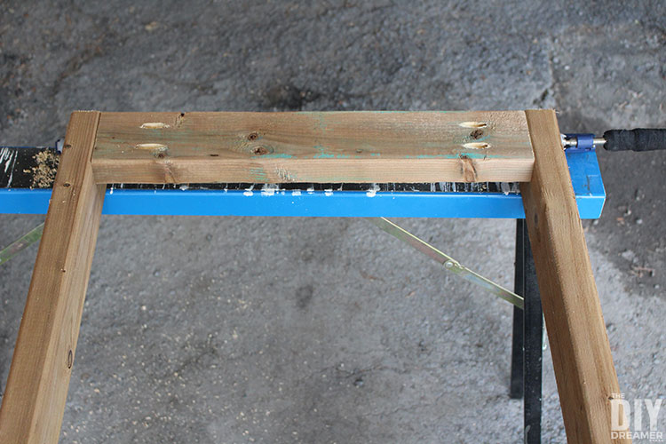 Assembling legs to a table.
