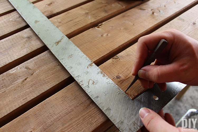 Make punch holes in the wood to mark where to insert screws. Using a square will make sure the line is straight.