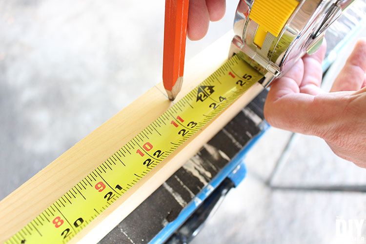 Measuring a 2x2 to cut.