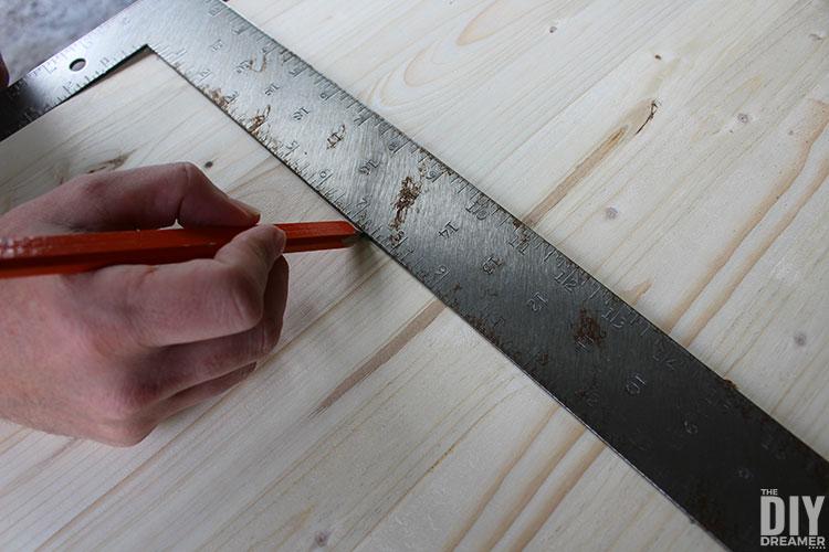 Use a carpenter square to make a straight line.