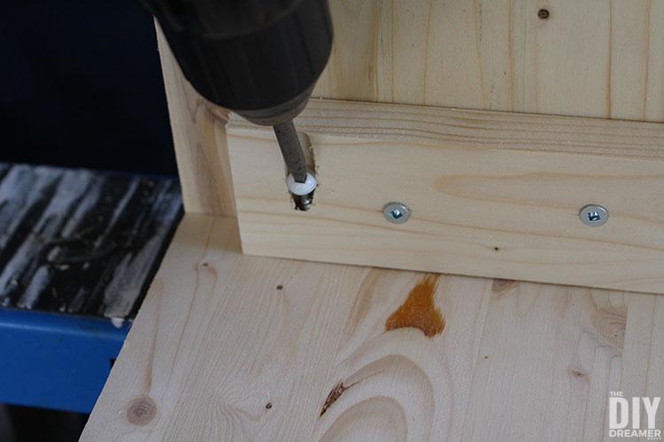 Fastening with screws.