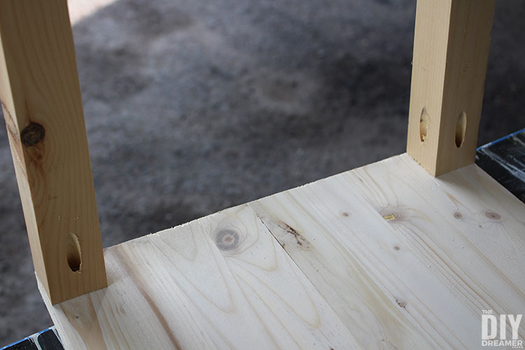 Table legs attached to the bottom of the side table.