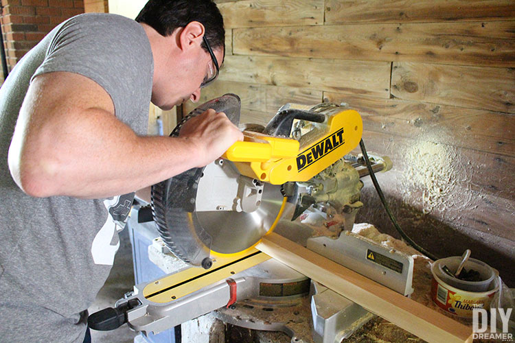 Cuting a 2x2 with a miter saw.