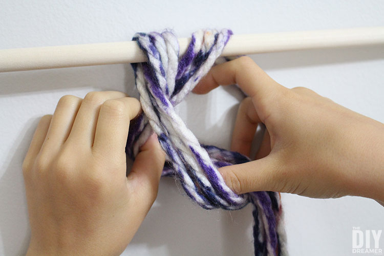 Place yarn strands into the loop.