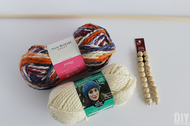 Supplies to make a yarn wall hanging with beads