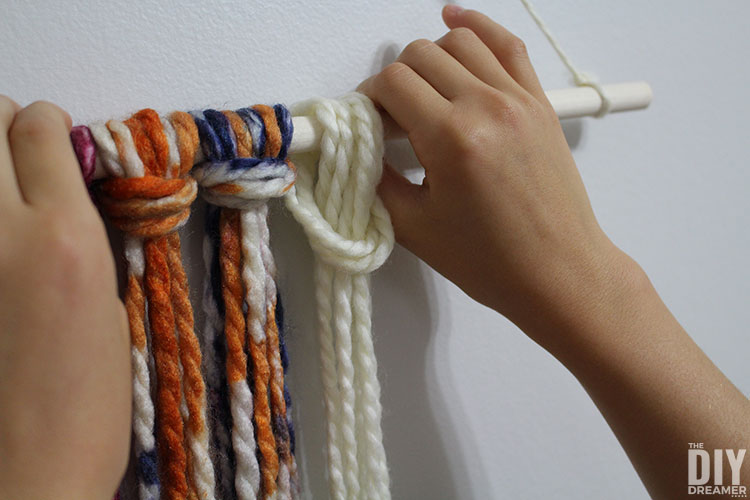 Tighten knot by pulling strands.