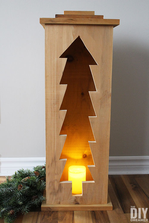 Christmas tree wood box with battery operated candle.