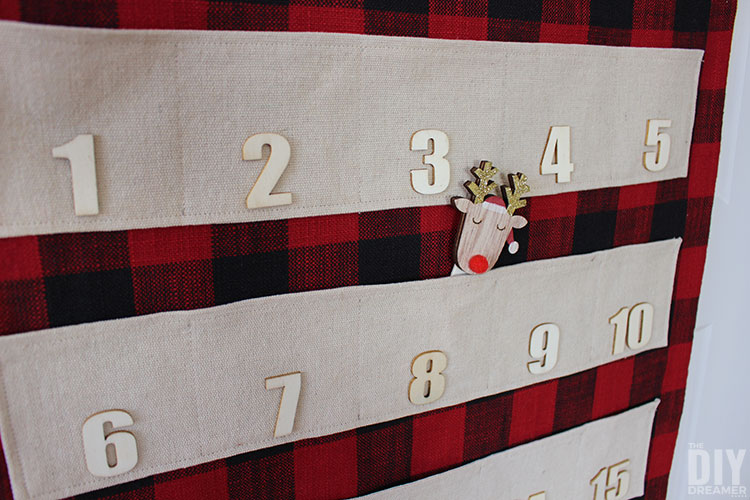 Fabric advent calendar Christmas door decoration.