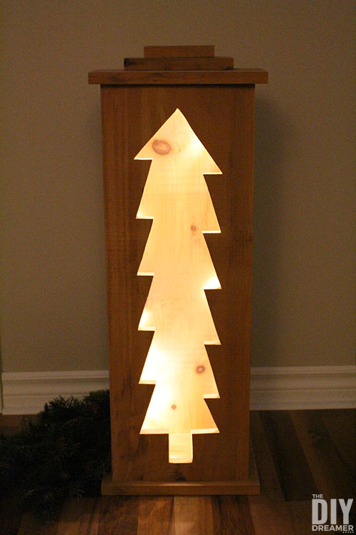 Christmas tree light box with string lights.