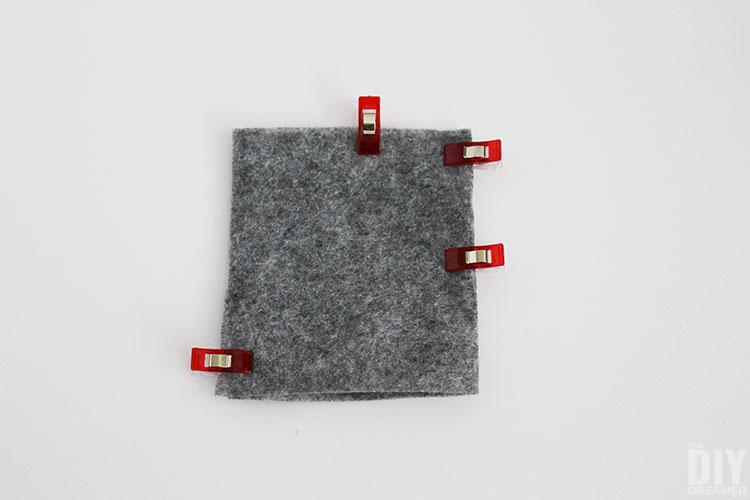 Grey felt folded and pinned in half.