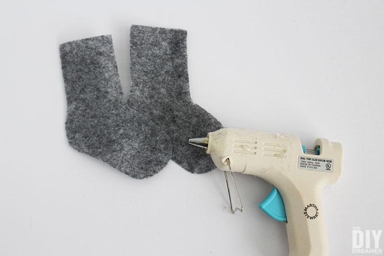 Glue edges of felt wool socks.