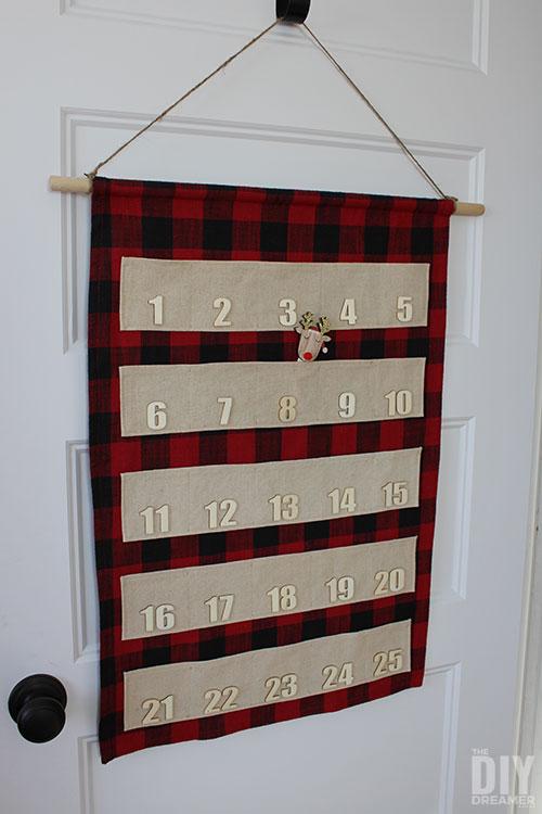 Hang fabric advent calendar on a door hook.