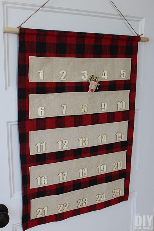 DIY hanging fabric advent calendar with pockets.