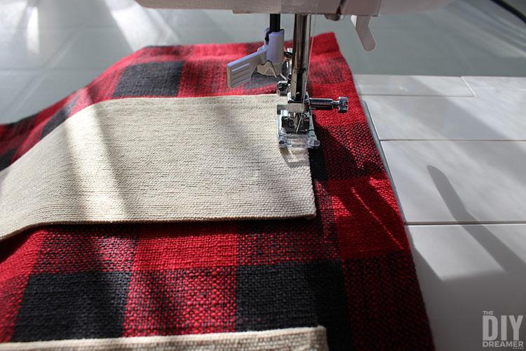 Sew strips to tea towel to make pockets.