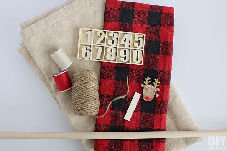 Supplies to make a fabric advent calendar.