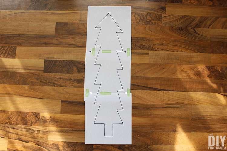 Assemble Christmas tree template with tape.