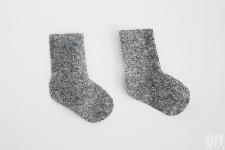 Two grey felt socks.