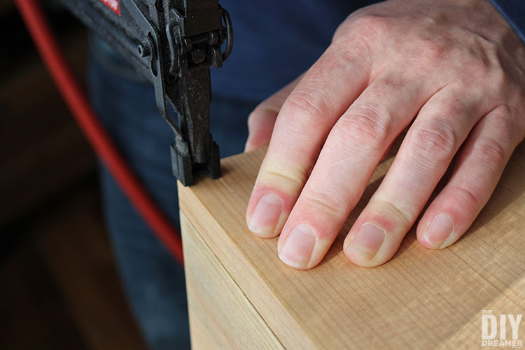 Use nail gun to attach the back.